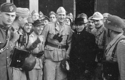 Skorzeny (centre, binoculars hanging from neck) with the liberated Mussolini – 12 September 1943