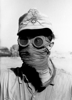 Goggles and face covering are worn to protect against sand storms.