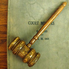 A gavel often symbolizes parliamentary procedure.