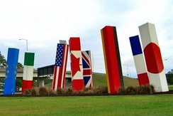 "Flag posts of G7 member countries plus the European Union titled ""Light Spikes"" located outside the airport entrance"