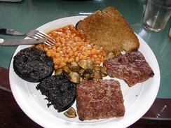 Full Scottish breakfast: Black pudding, Lorne sausage, toast, fried mushrooms and baked beans.
