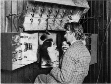 "Baird in 1925 with his televisor equipment and dummies ""James"" and ""Stooky Bill"" (right)."