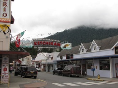 Ketchikan sign, which arches over Mission Street. Front Street is in the immediate foreground.