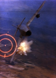An F-105D shoots down a MiG-17 during the Vietnam War, 1967.