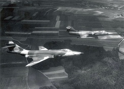 A German RF-104G in flight with a 66th TRW RF-101C.