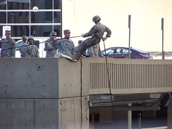 An Army ROTC unit practicing rapelling from a parking garage in September 2010