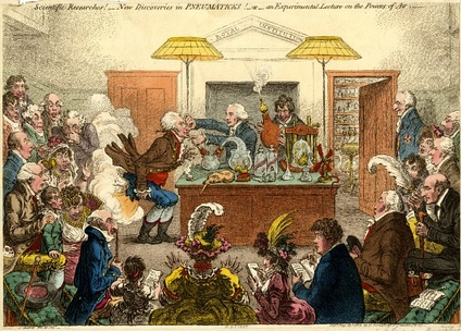 1802 satirical cartoon by James Gillray showing a Royal Institution lecture on pneumatics, with Davy holding the bellows and Count Rumford looking on at extreme right. Dr Thomas Garnett is the lecturer, holding the victim's nose.