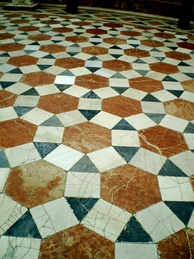 A rhombitrihexagonal tiling: tiled floor in the Archeological Museum of Seville, Spain, using square, triangle and hexagon prototiles