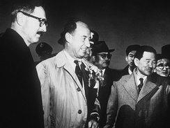 Stevenson in March 1953 at U.S. Air Force 17th Bomb Wing base in Korea, joined by US ambassador to Korea Ellis O. Briggs (left), acting foreign minister of the Republic of Korea Cho Chong-Hwan (second from right) and acting prime minister of the Republic of Korea Taik Tu-chin (far right)
