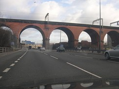 The M60 motorway as it passes beneath Stockport viaduct