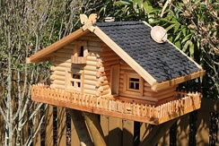 Birdhouse made to look like a real house