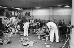 Mechanics work on the UDT Laystall team cars prior to the 1962 Dutch Grand Prix