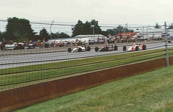 Front row during the pace laps. Outside (Mario Andretti), middle (A. J. Foyt), inside (Rick Mears)