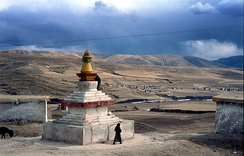 Tibetan Buddhist stupa and houses outside the town of Ngawa, on the Tibetan Plateau.