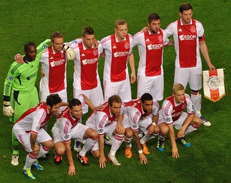 2011 AFC Ajax team wearing their home kit by adidas with the AEGON sponsor across the chest, ahead of their UEFA Champions League match against Olympique Lyonnais.