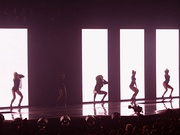 "Immediately after Beyoncé finished with the performance of ""Get Me Bodied"" with her background dancers, (left) they went in front of a holographic background continuing with ""Baby Boy"" (right)."