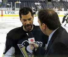 Bill Guerin of the Pittsburgh Penguins (left) is interviewed by HNIC reporter Elliotte Friedman before a May 8, 2010 playoff game against the Montreal Canadiens at Mellon Arena