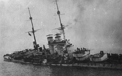 The sinking of SMS Szent István, after being torpedoed by Italian motor boats
