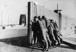 Dutch troops close the barrier of the Nijmegen Waal bridge during the Albania crisis.
