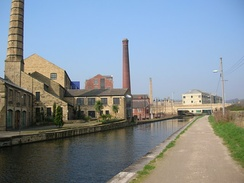 Mill buildings alongside the Leeds and Liverpool Canal in Shipley
