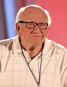 Ed Asner won the award in both lead and supporting actor categories for his work on Rich Man, Poor Man (1976) and Roots (1977).