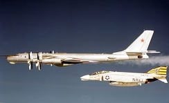 United States Navy F-4 Phantom II intercepts a Soviet Tupolev Tu-95 D aircraft in the early 1970s.