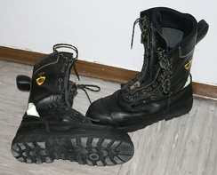 A pair of ISO 20345:2004 compliant S3 HRO HI CI FPA safety boots for firefighters featuring a laced in quickzip boot closure