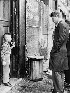 Kennedy speaks with a youth while touring Bedford–Stuyvesant in Brooklyn, N.Y., February 1966