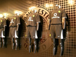 Manchester United replica strips on display.