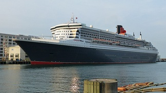 Queen Mary 2 of 2004 (151,400 GT), the world's largest ocean liner, docked in Boston Harbor as part of a tour to mark Cunard's 175th anniversary in 2015