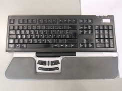Keyboard with roller bar mouse