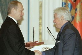 "Russian President Vladimir Putin presents Voinovich with the State Prize of the Russian Federation on 12 June 2001. The prize was awarded for the book ""Monumental propaganda"" about Neo-Stalinist legacy sitting in the subconscious of Russian citizens"