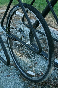 A bicycle wheel remains chained in a bike rack after the rest of the bicycle has been stolen at east campus of Duke University in Durham, North Carolina.