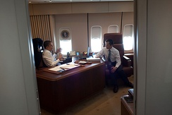 President Barack Obama meets with Rep. Dennis Kucinich, D-Ohio, aboard Air Force One en route to Cleveland, Ohio, March 2010.