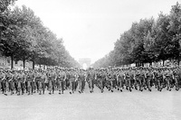 American troops of the 28th Infantry Division march down the Avenue des Champs-Élysées, Paris, in the Victory Parade on 29 August 1944.