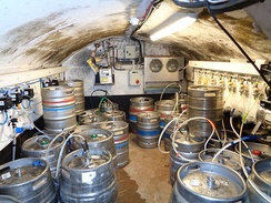 Cellars are often used in pubs to keep beer barrels connected to the bar at ground level.
