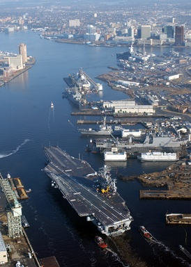 View of the Elizabeth River with Downtown Norfolk at top right. The carrier in the foreground is USS Harry S. Truman (CVN-75).