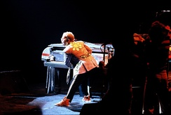 Elton on the piano during a live performance in 1975