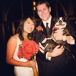 Aukerman (center) with wife, Kulap Vilaysack, and their dog, Rocky