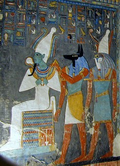 Egyptian tomb painting showing the gods Osiris, Anubis, and Horus, who are among the major deities in ancient Egyptian religion[85]