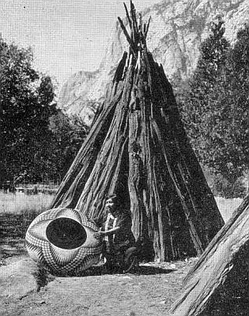 Artist Lucy Telles and large basket, in Yosemite National Park, 1933