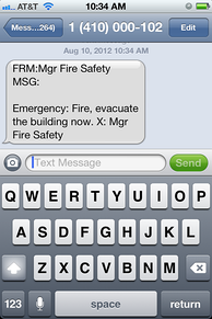 Example of an emergency SMS text message on a mobile phone. This exemplifies one potential weakness of using SMS for emergency communications, namely that messages can be forged.