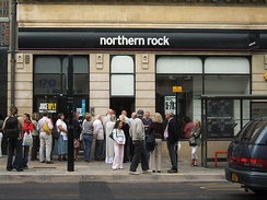 People queuing outside a Northern Rock branch in the United Kingdom to withdraw their savings during the financial crisis.