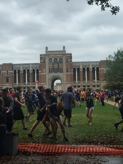 Rice University students participating in the Beer Bike water balloon fight in front of the Sallyport.