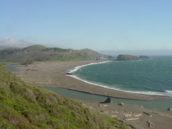Goat Rock Beach as viewed from the Jenner Cliffs looking south, showing the mouth of the Russian River at the Pacific Ocean.