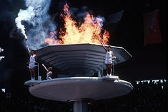 South Koreans stand next to the 1988 Summer Olympic cauldron