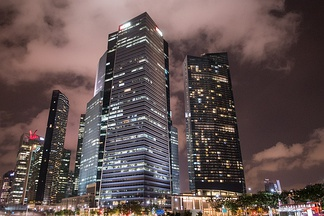 Most large investment banks maintain central offices in financial centers. Pictured: Singapore Financial District.