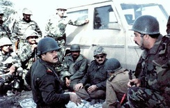 Iraqi commanders discussing strategy on the battlefront (1986)