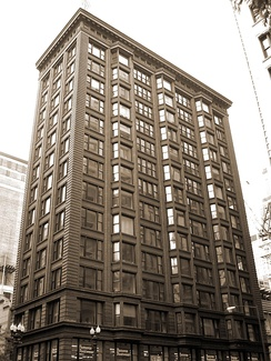 The Chicago Building is a prime example of Chicago School architecture.