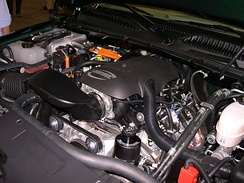 The engine compartment of a 2006 GMC Sierra Hybrid